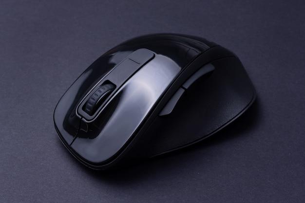 Black computer mouse on black