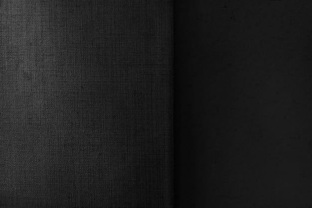 黒のコンクリートとキャンバス生地の織り目加工の背景