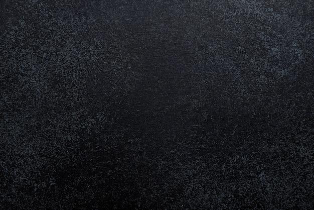 黒いコンクリートの背景。上面図。