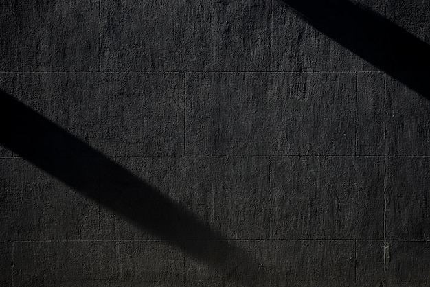Black concrete wall with shadows