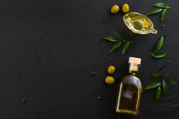Black copy space background with olive oil
