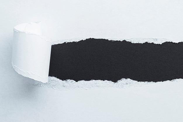 Black copy space under white torn paper