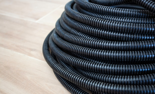 Black corrugated pipe for the cable.