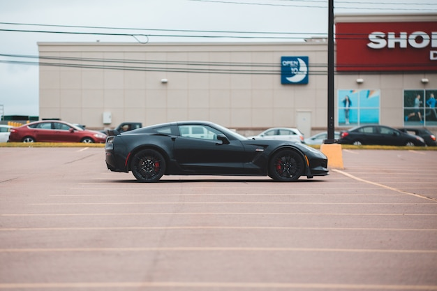 Black coupe car in parking lot