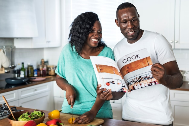 Black couple cooking in the kitchen together