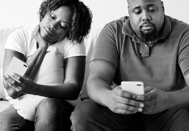 Black couple using digital device