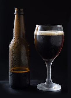 Black craft beer without labels on black