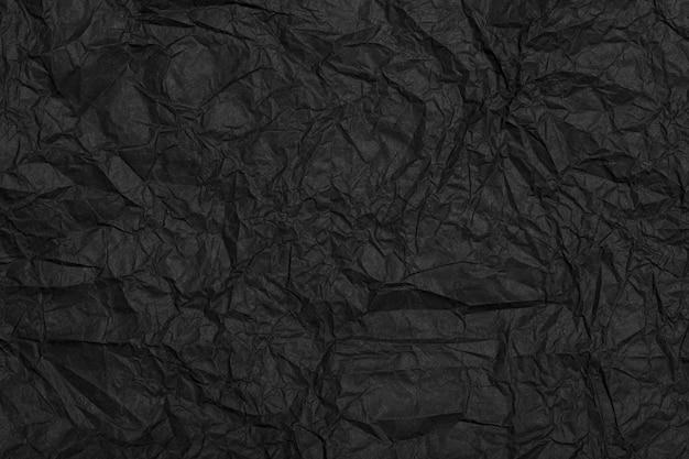 質感としわ効果のある黒く細工された再生紙は、高品質の黒のしわくちゃの紙を裏打ちしています...