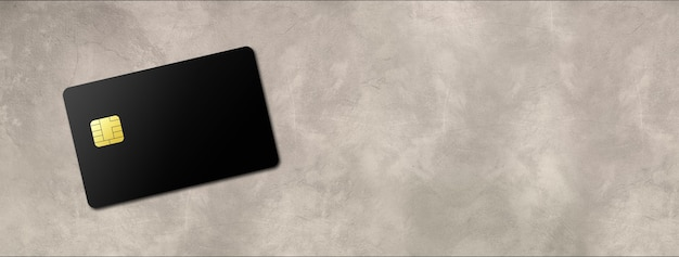 Black credit card template on a concrete background banner. 3d illustration