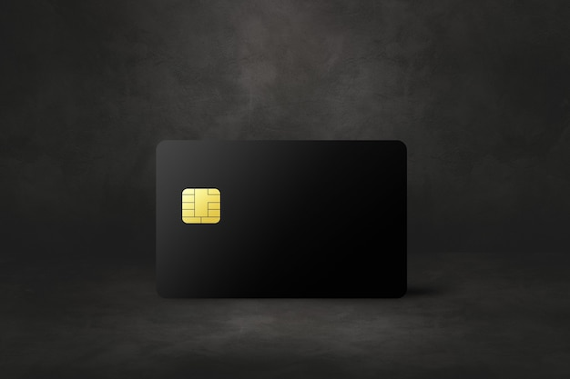 Black credit card template on a dark concrete background. 3d illustration