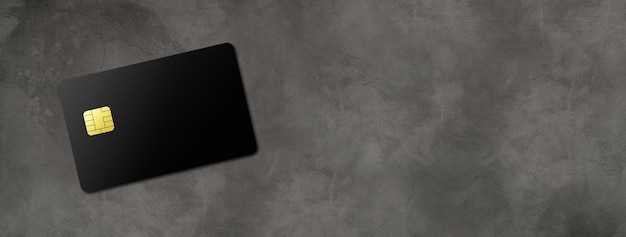 Black credit card template on a dark concrete background banner. 3d illustration