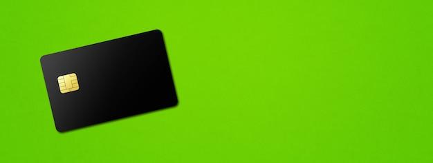 Black credit card template on a green banner. 3d illustration
