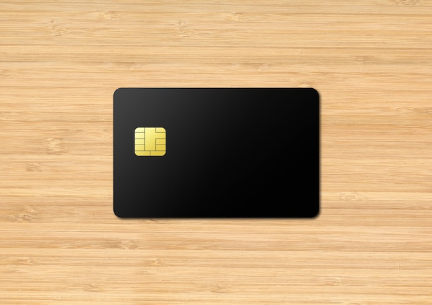 Black credit card template on a wooden table. 3d illustration