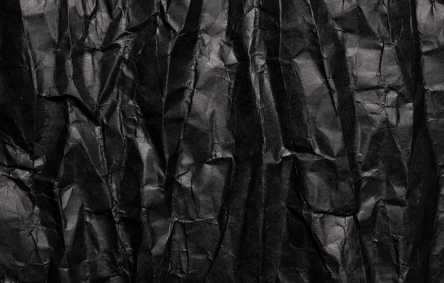 Black crumpled paper texture, grunge background