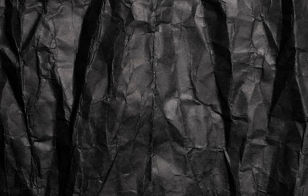 Black crumpled paper texture, old grunge background