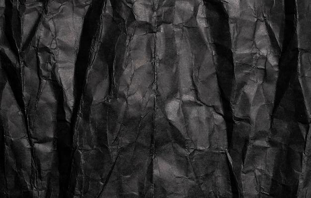 Текстура черной мятой бумаги, старый гранж-фон