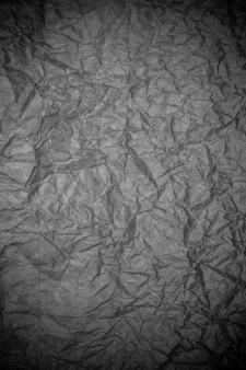 黒のしわくちゃの紙の質感。