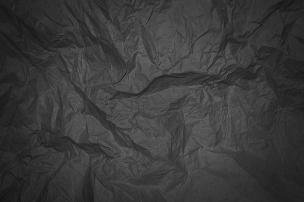 Black crumpled sheet of paper with vignetting