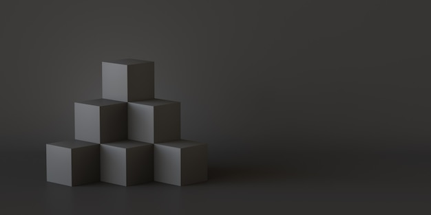 Black cube boxes with dark wall background