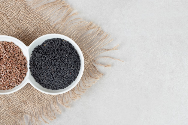 Black cumin spices isolated on concrete.