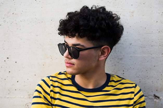 Black curly guy in sunglusses and striped shirt