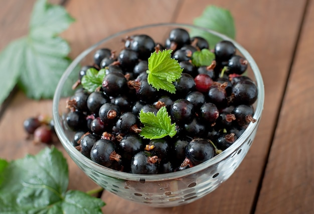 Black currants in a glass bowl