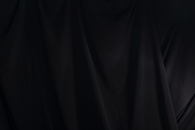 Black curtain drape wave, wallpaper background texture detail
