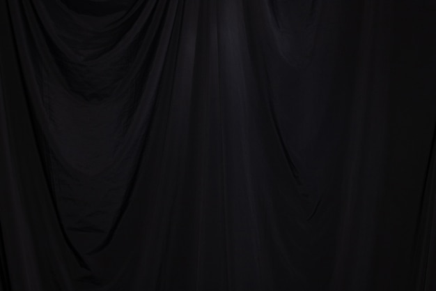 Black curtain drape wave