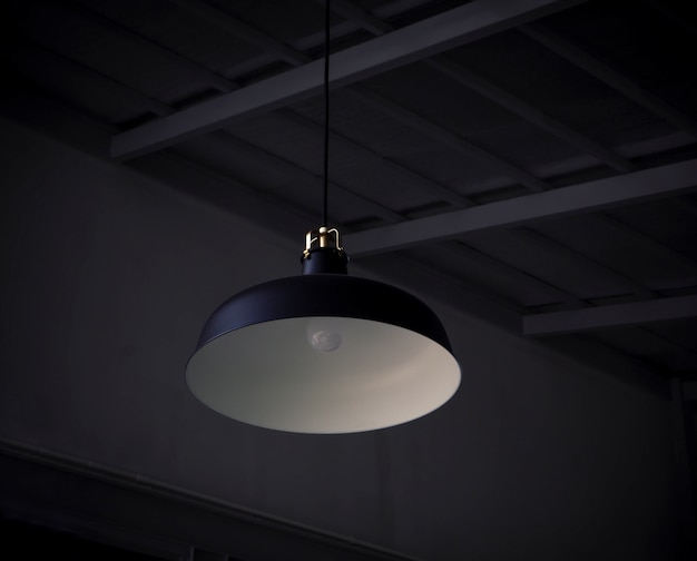 Black decorative lamp hanging from the ceiling decoration in hotel