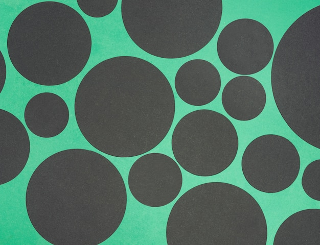Black design circle shape on green background
