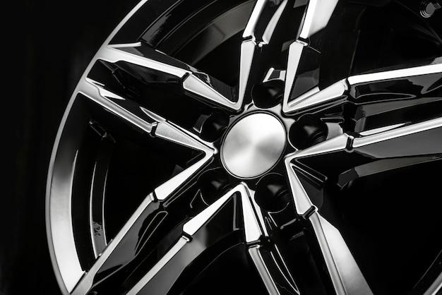 Black designer alloy wheel shaped like a star. close-up details.