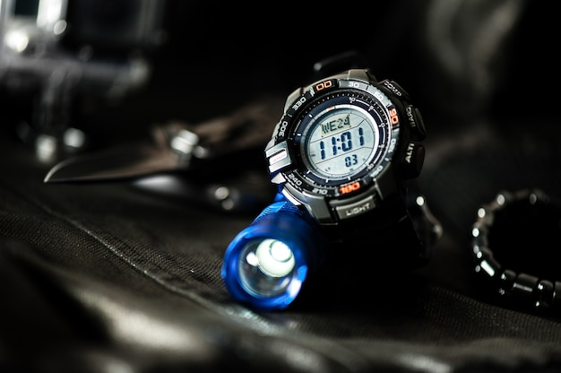Black digital watch for outdoor activities with stopwatch feature, countdown timer, backlight and water resistance.