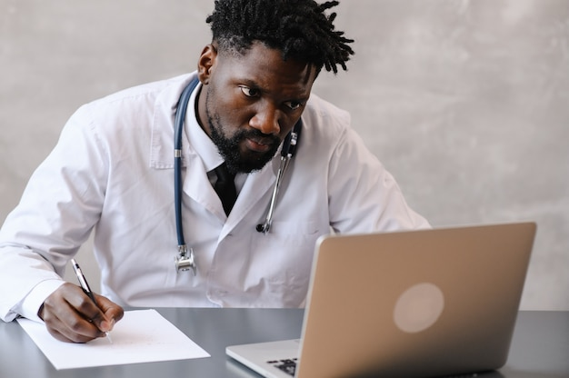 Black doctor. telemedicine the use of computer and telecommunications technologies for the exchange of medical information.