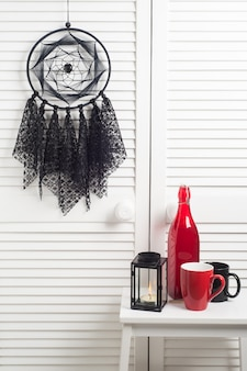 Black dream catcher with crocheted doilies