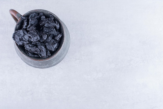 Black dried sultanas isolated on concrete background. high quality photo
