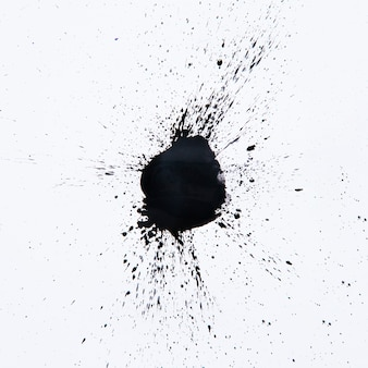 Black droplet splashes on white
