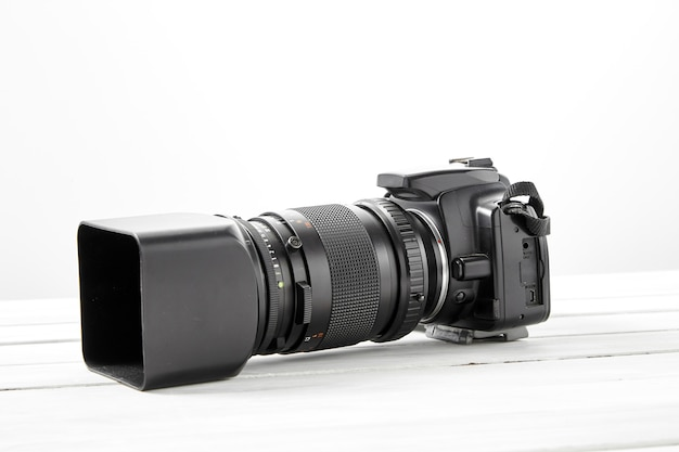 Black dslr camera with tele lens