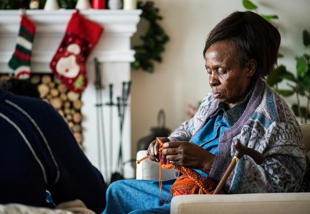 A black elderly woman in chrismas holiday