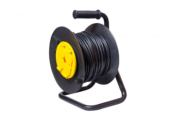 Black electrical extension cord on a take-up reel with four sockets