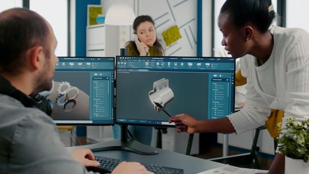Black employee pointing on monitor explaining project