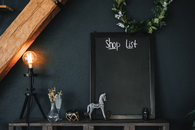 Black empty board in the kitchen for shopping list. mock-up.