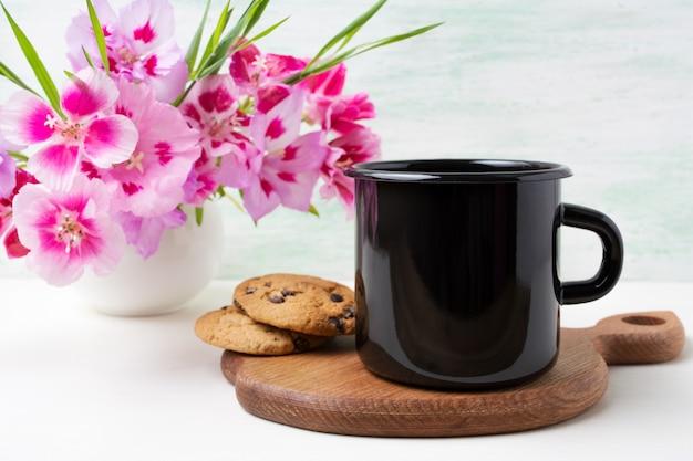 Black enamel mug with pink clarkia flowers