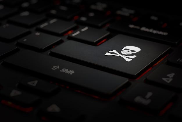 Black enter key with pirate symbol