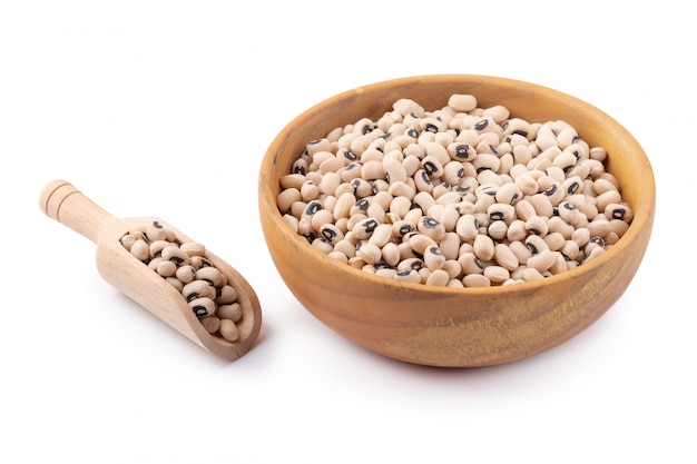 Black-eyed peas in a wooden bowl isolated on a white background