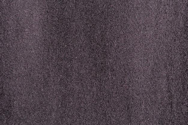 Текстура полиэстера ткани черной ткани и предпосылка ткани.