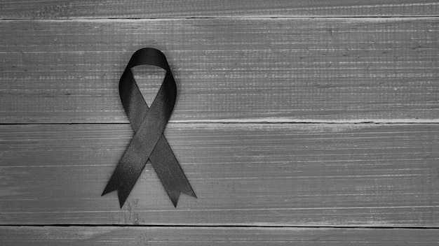 Black fabric ribbon on a wood desk