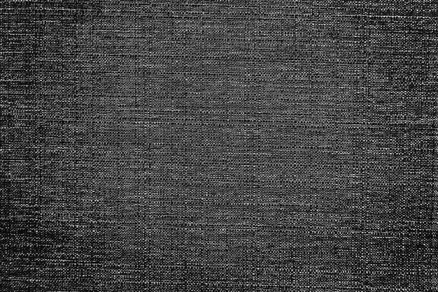 Black fabric rug with a textured background
