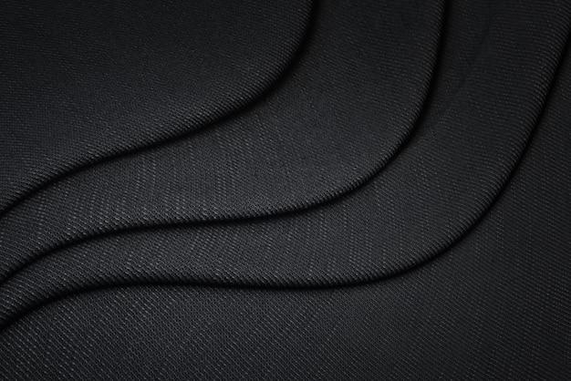 Черная ткань текстуры фона. пустой роскошный хлопковый текстиль и материал.