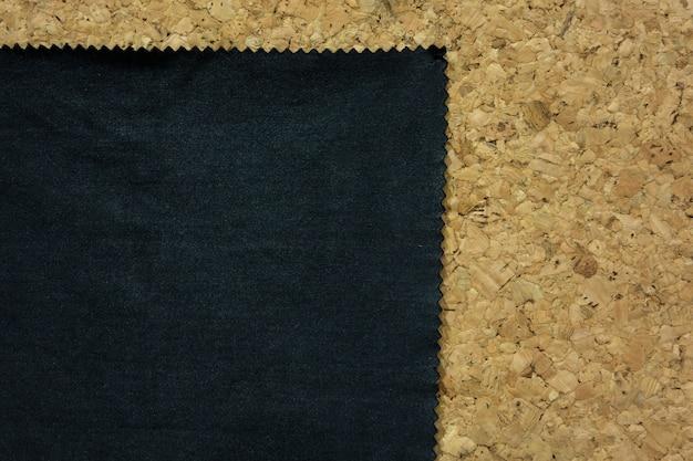 Black fabric with zig zag edge on cork board