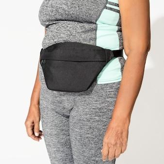 Black fanny bag on active woman's hip